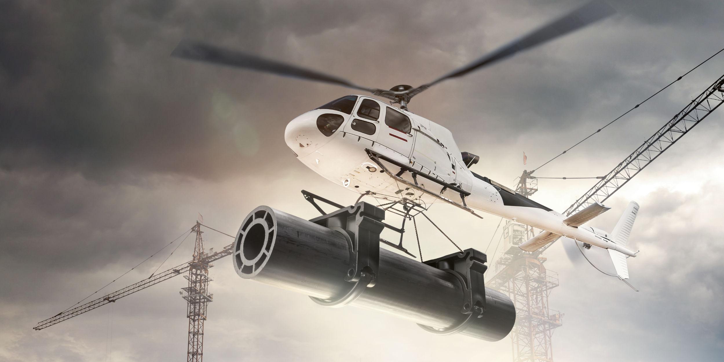 Kampagnen Fotografie Fellbach Stuttgart und Umgebung W52 JM Jäger Technology To Connect Helikopter Plastikrohr Baukräne Transport